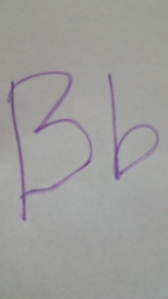 B! I tried holding her hand while writing Big B little B!