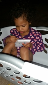 Tracing my letter C, in the laundry basket, in her pull ups! lol