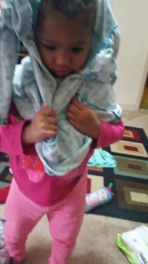 "Trying to dress herself, she told me ""all done mommy!"" haha so precious"