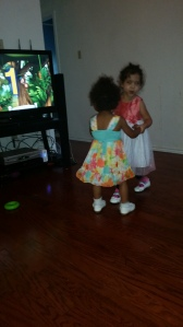 Emma and Brielle dancing.