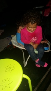 Brielle sitting on Ian in the baby chair! lol