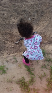 helping her Granny and PawPaw shovel for their garden! :)