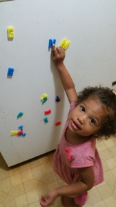 She found N on the fridge all by herself :)