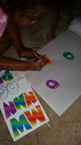 She picked the letter O out on her stickers and decided to trace them!