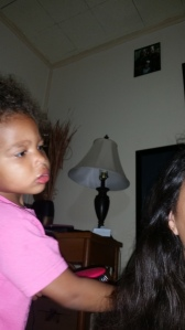 Brielle is very orderly! She has to do these her way.. even my hair! :)