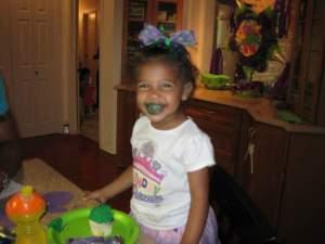 eating her cupcake!