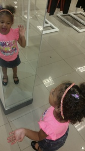 talking to herself in the mirror! :)