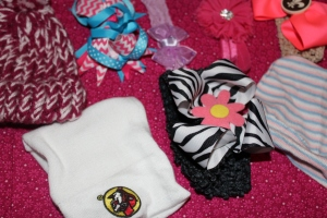 Some of her favorite bows, headbands, and hats