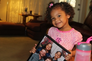 Brielle holding one of David's favorite pictures! It's of me, my brother, David and my Mom! :)